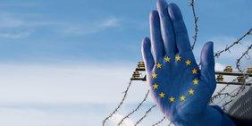 Abwehrende blaue Hand mit EU-Symbol vor Stacheldrahtzaun