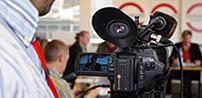 Videokamera auf einer Pressekonferenz